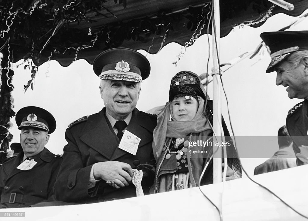 Turkish Head of State Kenan Evren meeting a little girl in traditional dress as he prepares to make a speech 1981