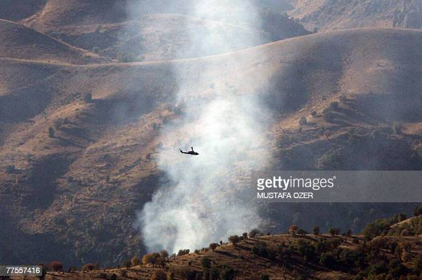 Turkish helicopters fly over the Cudi mountain during an attack on an outlawed Kurdistan Workers Party camp 30 October 2007 in the Cudi mountains...