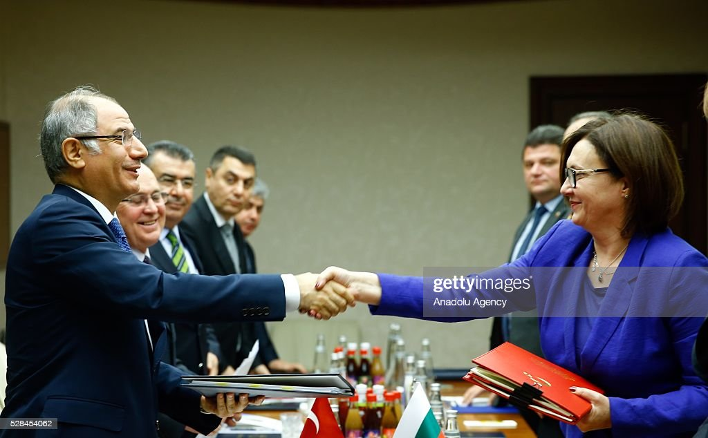 Turkish Interior Minister Efkan Ala (L) and Bulgarian Interior Minister Rumyana Bachvarova (R) attends a signing ceremony on eon implementation of the EU-Turkey agreement on accepting back illegally staying individuals in Ankara, Turkey on May 5, 2016.