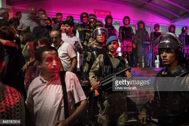 Turkish Jandarma soldiers guard the entrance to the Silivri Courthouse as journalists lawyers and family members leave the courthouse after the...