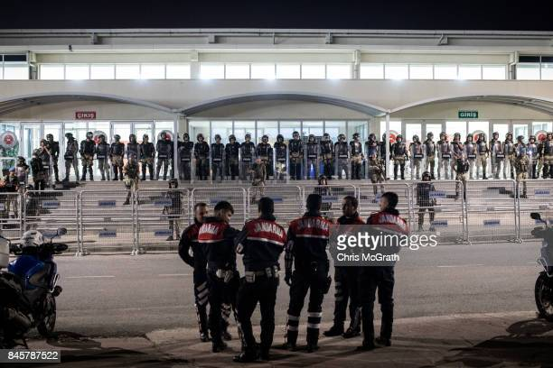 Turkish Jandarma soldiers guard the entrance to the Silivri Courthouse while awaiting the courts decision during the ongoing trial of journalists...