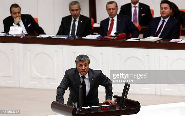 Turkish journalist and Republican People's Party MP Mustafa Balbay delivers a speech as lawmakers debate the government's budget proposal during a...