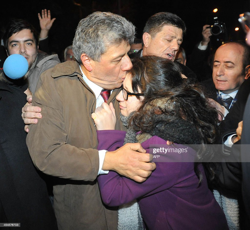 Turkish journalist Mustafa Balbay is conforted by relatives on December 9 2013 after being released from prison in Sincan near Ankara Balbay has been...