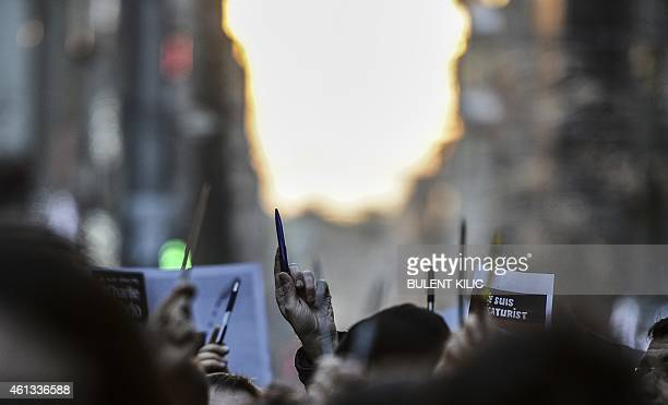 Turkish journalists hold pencils and boards on Istiklal avenue in front of French consulate during a rally they organized on Istiklal avenue on...