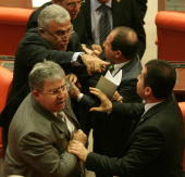 Turkish lawmakers of the main opposition Republican People's Party and members of the ruling Justice and Development Party scuffle at the parliament...