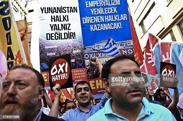 Turkish leftist people marche with placards reading 'NO' and 'Greek people is not alone' in solidarity with Greek people on July 4 2015 at the...