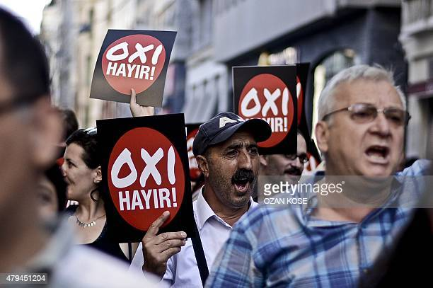 Turkish leftist people marched with placards says 'NO' in solidarity with Greek people on July 4 2015 at the Istiklal avenue in Istanbul on the eve...