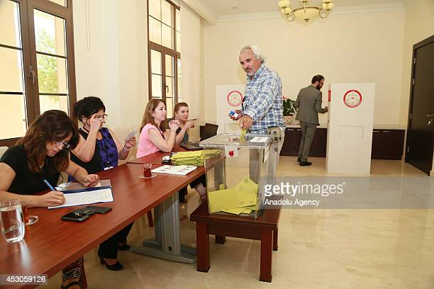 Turkish man casts his ballot in the Turkey's presidential election at the Turkish Embassy in Doha Qatar on August 02 2014 Turkish people living in...
