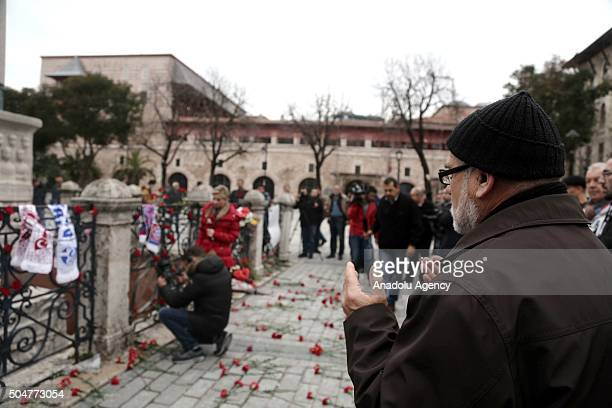 Turkish man prays for the ones who lost their lives in an attack at Sultanahmet square after it has been reopened to media and public in Istanbul...