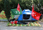 A Turkish man protesting against the military coup rests near his tent in a public garden in Ankara on July 25 2016 Turkish authorities on July 25...