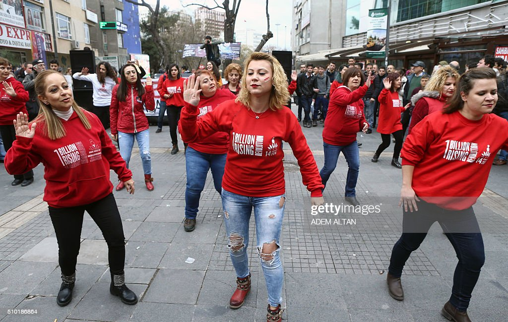 Turkish members of the 'One Billion Rising' movement, dance during a demonstration to denounce violence and injustices against women, on Valentine's Day in Ankara, on February 14, 2016. / AFP / ADEM ALTAN