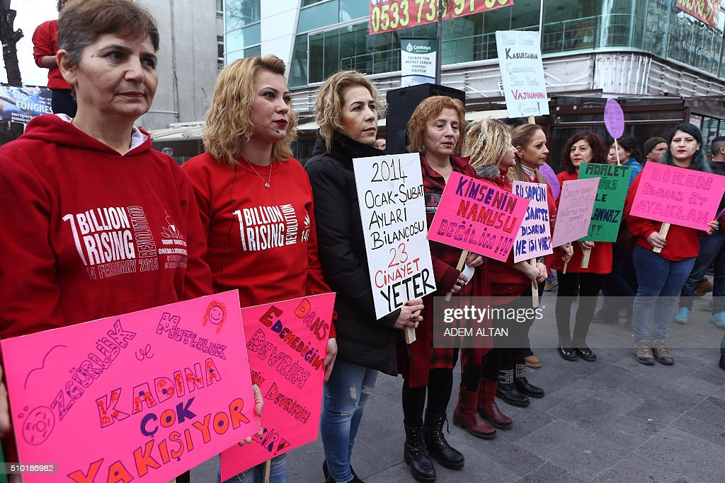Turkish members of the 'One Billion Rising' movement, hold placards condemning violence and injustices against women during a mass action on Valentine's Day in Ankara, on February 14, 2016. / AFP / ADEM ALTAN