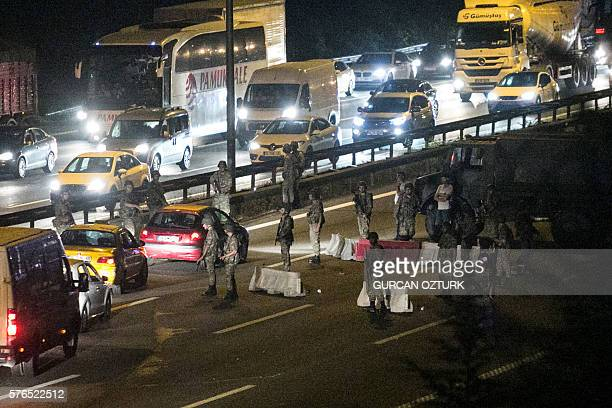 Turkish military control a road in Istanbul on July 16 after Turkish troops launched a coup Turkish military forces on July 16 opened fire on crowds...