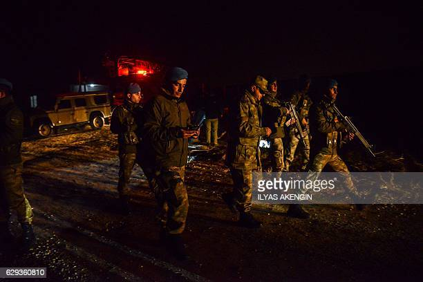 Turkish millitary personnel arrive near a Turkish F16 war plane which crashed in Diyarbakir on December 12 2016 A Turkish fighter jet crashed near an...