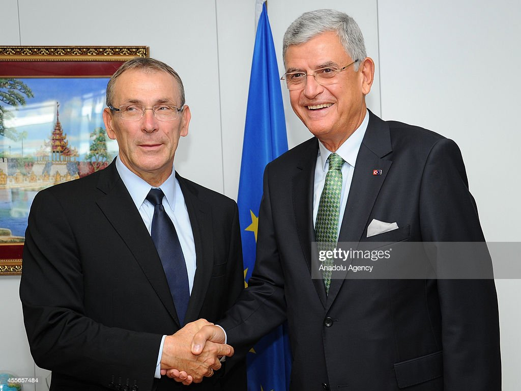 Turkish Minister for EU Affairs Chief Negotiator Volkan Bozkir and EU development commissioner Andris Piebalgs shake hands in Brussels Belgium on...