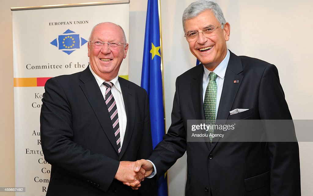 Turkish Minister for EU Affairs Chief Negotiator Volkan Bozkir and President of the Committee of the Regions Michel Lebrun shake hands in Brussels...