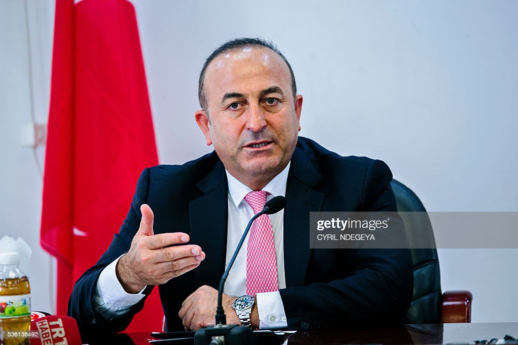 Turkish Minister for Foreign Affairs Mevlut Cavusoglu speaks to the press after a metting with Rwandan Minister for Foreign Affairs in Kigali on May 31, 2016. Rwanda-Turkey agreements are expected to strengthen economic ties between the two countries through trade promotion, co-ordination, as well as information, skills and knowledge sharing. Cavusoglu also officially opened the new Turkish embassy in Kigali. / AFP / CYRIL