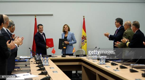 Turkish Minister of Defense Nurettin Canikli and Spanish Minister of Defense Maria Dolores de Cospedal pose for a photo after they signed the...