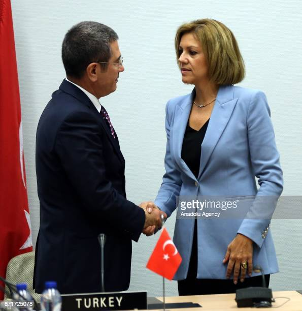 Turkish Minister of Defense Nurettin Canikli shakes hands with Spanish Minister of Defense Maria Dolores de Cospedal after they signed the...