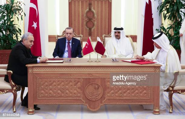 Turkish Minister of Food Agriculture and Livestock Ahmet Esref Fakibaba signs an agreement on behalf of Turkey as he is flanked by President of...
