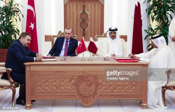 Turkish Minister of Forestry and Water Veysel Eroglu signs an agreement on behalf of Turkey as he is flanked by President of Turkey Recep Tayyip...