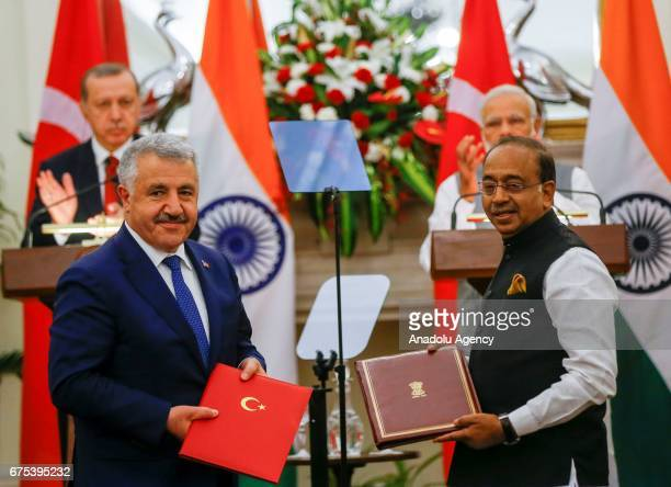 Turkish Minister of Transport Maritime and Communication Ahmet Arslan and Minister of Youth Affairs and Sports of India Vijay Goel pose for a photo...