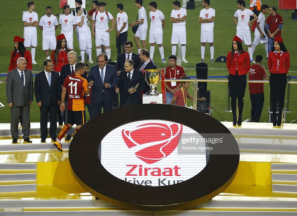 Turkish Minister of Youth and Sports Akif Cagatay Kilic (R) and President of the Turkish Football Federation (TFF) Yildirim Demiroren (R-2) give medals to Football players of Galatasaray after Galatasaray won the Ziraat Turkish Cup Final match between Galatasaray and Fenerbahce at Antalya Ataturk Stadium in Antalya, Turkey on May 26, 2016.