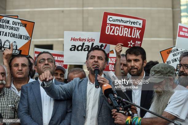 Turkish MPs Baris Yarkadas and Sezgin Tanrikulu of the main opposition Republic People's Party speak to the press in Istanbul on July 28 2017 after a...