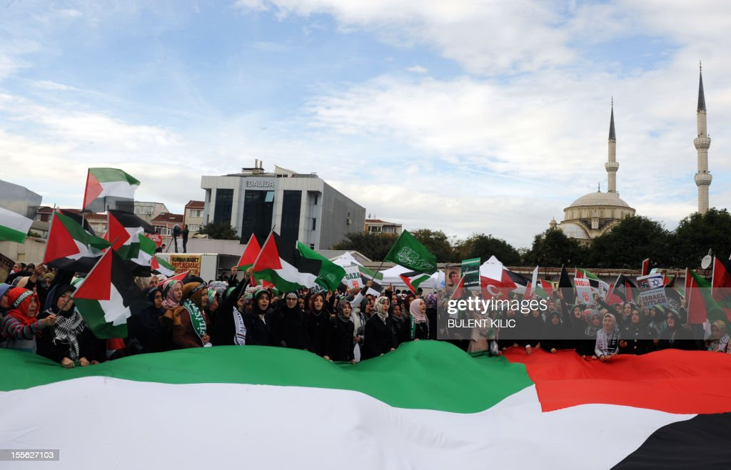 Turkish muslim protesters hold a giant Palestinian flag as they gathered in front of the courtroom, on November 6, 2012, in Istanbul. Four Israeli ex-military chiefs went on trial in absentia in an Istanbul court over a deadly 2010 raid on a Gaza-bound Turkish ship in what Israel branded a 'show trial' by its former ally. Prosecutors are seeking life sentences for the four over the night-time assault in international waters in the Mediterranean Sea that plunged relations between Israel and Turkey into deep crisis.