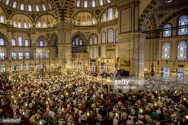Turkish Muslims offer Eid al Fitr prayers as they mark the first day of the Eid alFitr at Fatih Sultan Mosque on July 5 2016 in Istanbul Turkey Eid...