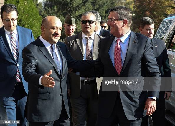Turkish National Defence Minister Fikri Isik welcomes US Secretary of Defence Ashton Carter before their meeting at the Ministry for National Defence...