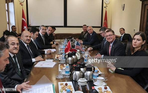Turkish National Defence Minister Fikri Isik welcomes US Secretary of Defence Ashton Carter attend a meeting at the Ministry for National Defence in...