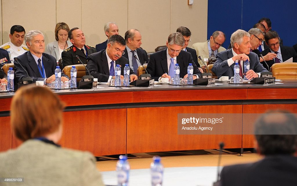 Turkish National Defense Minister Ismet Yilmaz (first row 2ndL) and the other NATO defence ministers attend the second day of defence ministers meeting in Brussels, Belgium on June 4, 2014. NATO defense ministers met with their Georgian counterparts on Wednesday to discuss security and cooperation issues.
