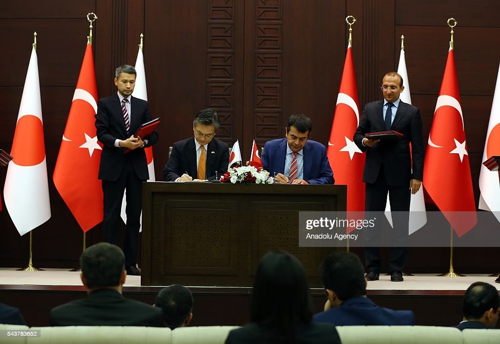Turkish National Education Ministry Undersecretary Yusuf Tekin (R) and Japanese ambassador to Ankara Hiroshi Oka sign a cooperation agreement regarding the foundation of Turkish-Japanese Science and Technology University in Istanbul, in Ankara, Turkey on June 30, 2016.