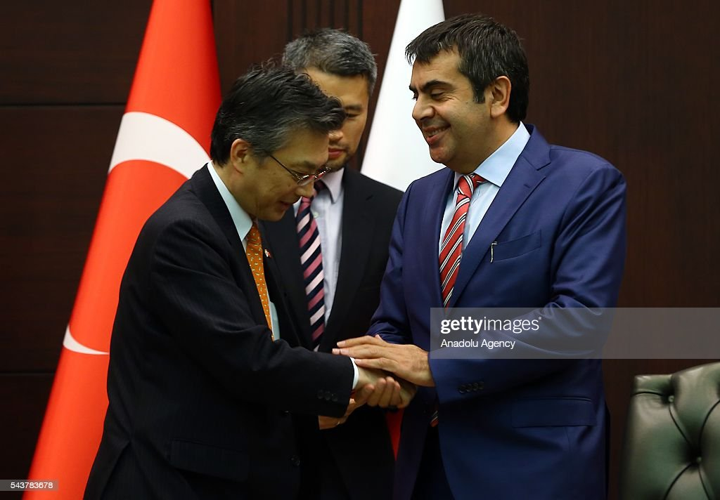 Turkish National Education Ministry Undersecretary Yusuf Tekin (R) and Japanese ambassador to Ankara Hiroshi Oka (L) shake hands after signing a cooperation agreement regarding the foundation of Turkish-Japanese Science and Technology University in Istanbul, in Ankara, Turkey on June 30, 2016.