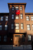 A Turkish national flag hangs from the window of the law faculty at Istanbul University in Istanbul Turkey on Tuesday July 19 2016 Moody's Investor...