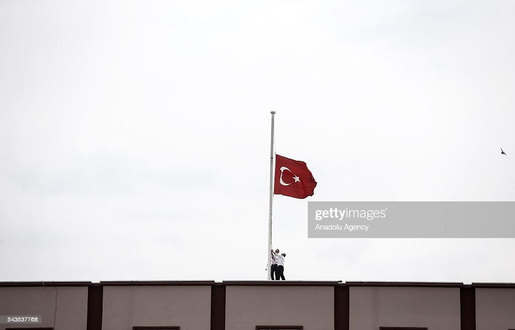 Turkish national flag is lowered at half-mast at the Interior Ministry in Ankara, Turkey on June 29, 2016 after at least 41 victims and three suicide bombers were killed while scores of others were injured in a terror attack on Istanbuls Ataturk International Airport.