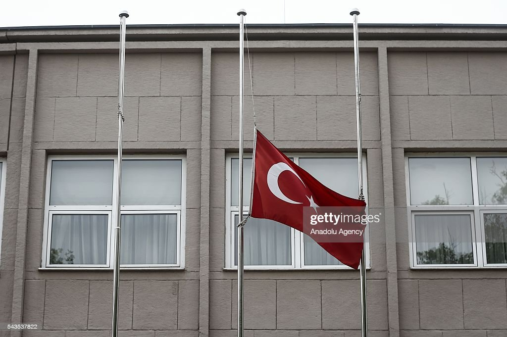 Turkish national flag is lowered at half-mast at the Prime Ministry in Ankara, Turkey on June 29, 2016 after at least 41 victims and three suicide bombers were killed while scores of others were injured in a terror attack on Istanbuls Ataturk International Airport.