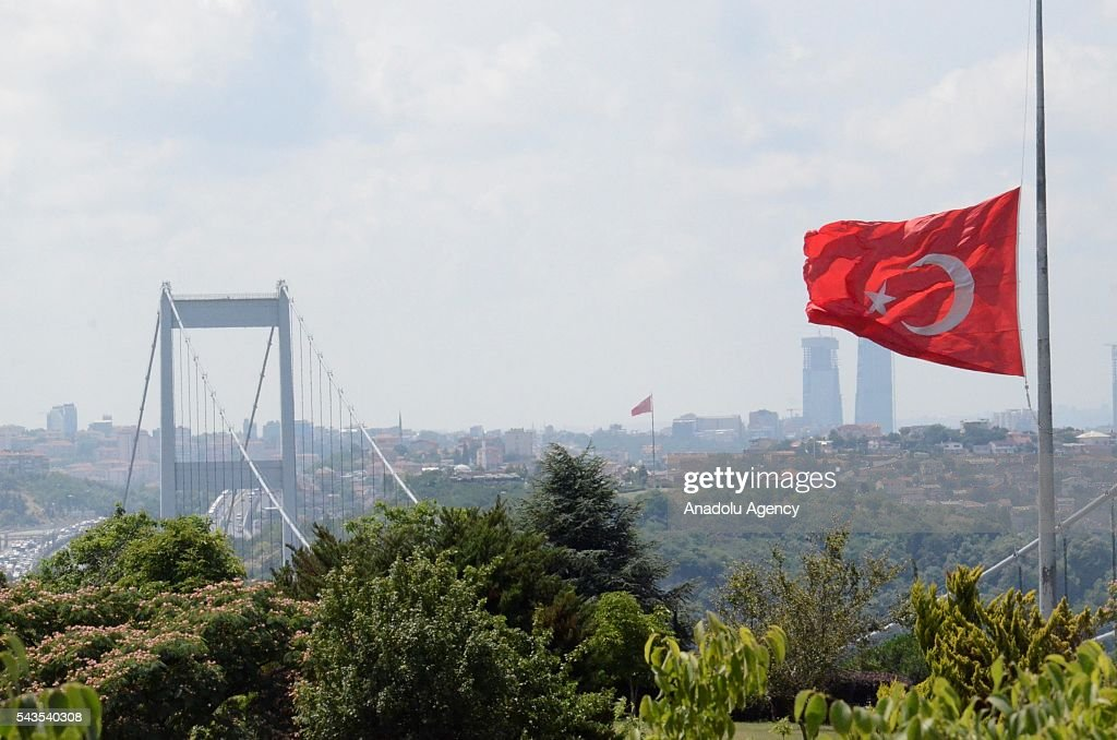Turkish national flag is lowered at half-mast in Istanbul, Turkey on June 29, 2016 after at least 41 victims and three suicide bombers were killed while scores of others were injured in a terror attack on Istanbuls Ataturk International Airport.