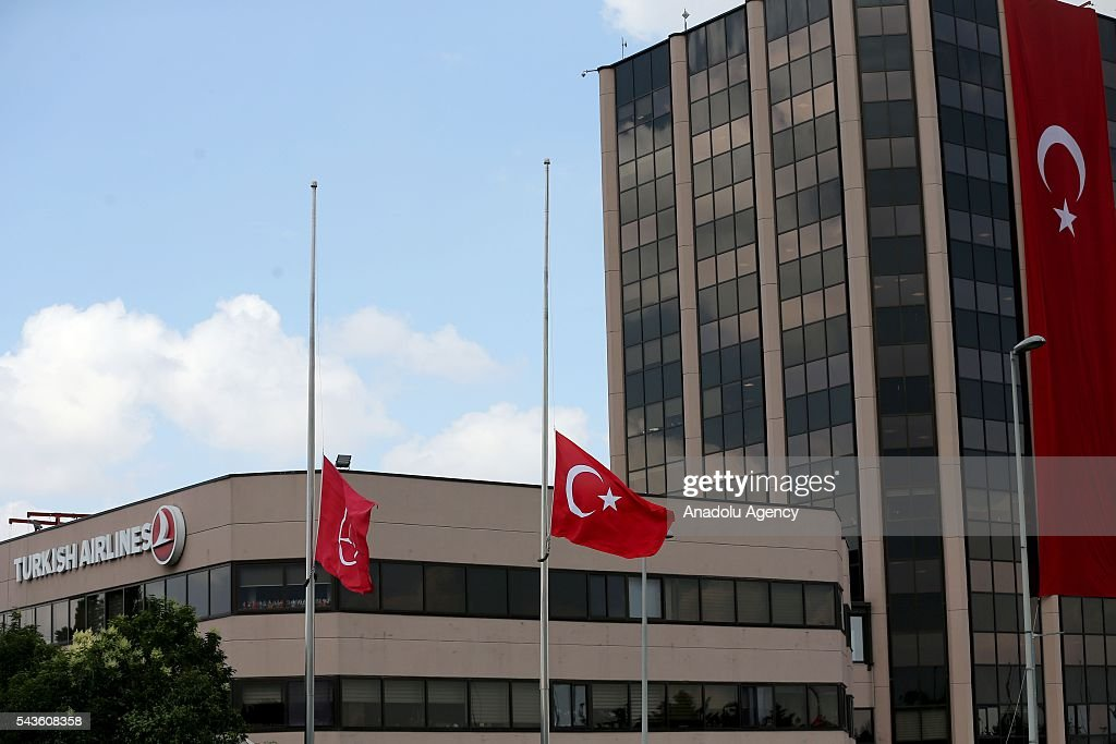 Turkish national flags are lowered at half-mast at Istanbuls Ataturk International Airport in Istanbul, Turkey on June 29, 2016 after at least 41 victims and three suicide bombers were killed while scores of others were injured in a terror attack on Istanbuls Ataturk International Airport.