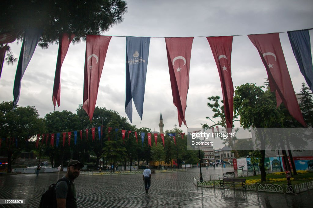 Turkish national flags hang from bunting in the Sultan Ahmed district of Istanbul, Turkey, on Friday, June 14, 2013. The law forbids the sale of alcohol at night and near schools and mosques, going against the secular traditions of the Muslim-majority country of 74 million, where many people drink and women often choose not to cover their hair. Photographer: Lam Yik Fei/Bloomberg via Getty Images
