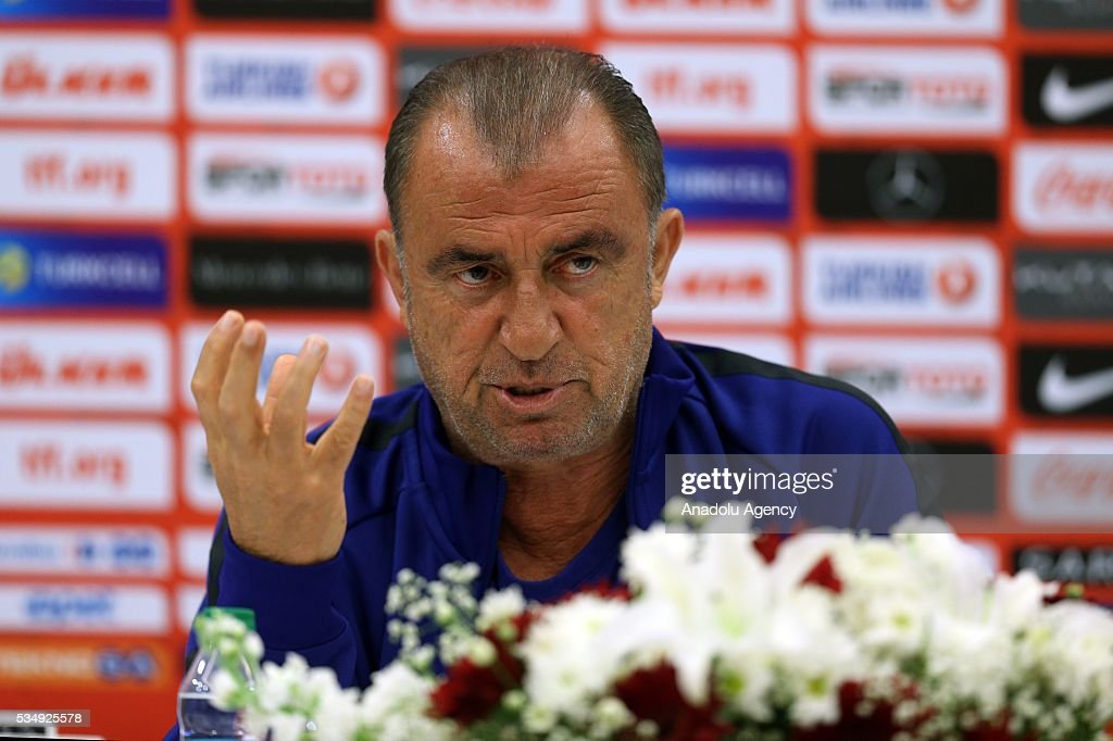Turkish national football team head coach Fatih Terim gestures as he speaks during a media conference at the Gloria Serenity Resort in Belek district of Turkey's Antalya province on May 28, 2016, ahead of a friendly game against Montenegro which will be played on May 29, 2016, at the Antalya Arena, as part of their Euro 2016 preparations.