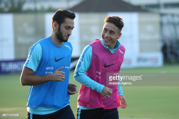 Turkish National Football Team players Emre Mor and Hakan Calhanoglu exercise during a training session ahead of the FIFA World Cup European...