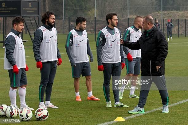 Turkish National Team's head coach Fatih Terim players Hakan Calhanoglu Selcuk Inan and Emre Belozoglu attend the training ahead of UEFA Euro 2016...