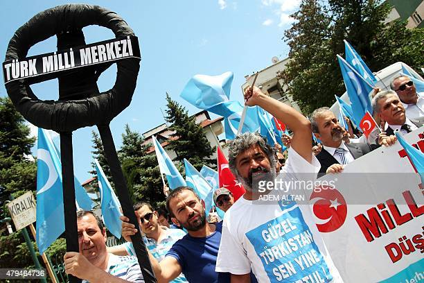 Turkish nationalists hold a black wreath as they demonstrate in front of the Chinese Embassy in Ankara on July 4 2015 to denounce the Chinese...