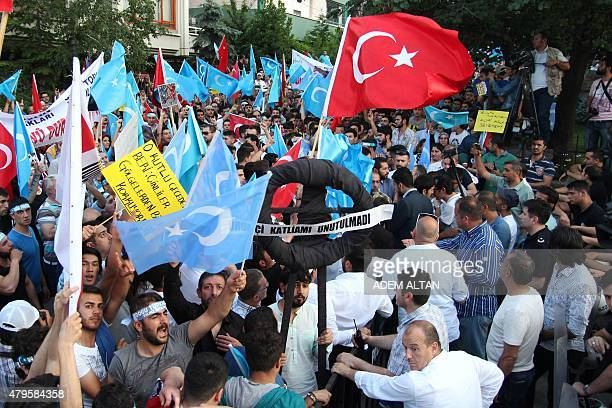 Turkish nationalists hold a black wreath as they demonstrate in front of the Chinese Embassy in Ankara on July 5 2015 to denounce the Chinese...