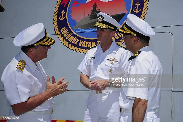 Turkish Naval Fleet Commander Admiral Nusret Guner left talks to Chief of Naval Operations CNO Admiral Jonathan Greenert aboard the Turkish navy...