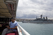 A Turkish naval warship passes a ferry boat on the Bosporus Strait in Istanbul Turkey on Wednesday July 20 2016 Moody's Investor Services said Monday...