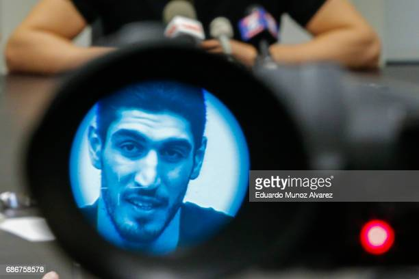 Turkish NBA Player Enes Kanter seen through a video camera speaks to the media during a news conference about his detention at a Romanian airport on...
