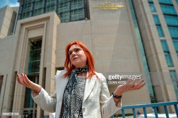 Turkish novellist Asli Erdogan gestures as she talks to media on June 22 2017 in front of Istanbul's courthouse after her trial A Turkish court on...